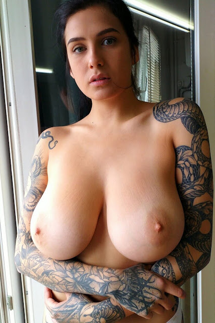 Tattooed nude model with amazing big boobs