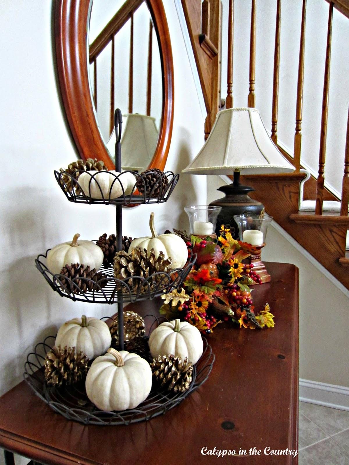 Fall foyer vignette using white pumpkins