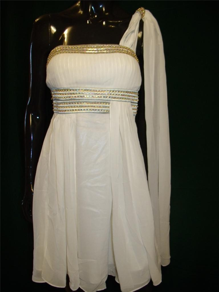 cc7d61b365 This stunning Grecian Goddess Mini Drape Party Dress will help you to  accomplish just that! This dress is in a beautiful white color with a touch  of gold ...