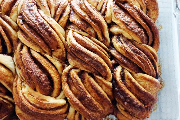 view of twisty cinnamon rolls in pan