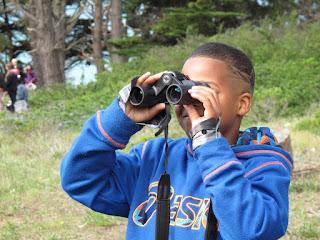 Boy looks through binoculars