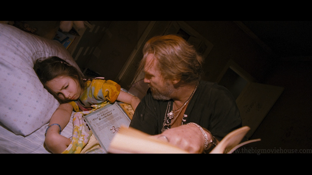 jeff bridges tries to read a book to his daughter
