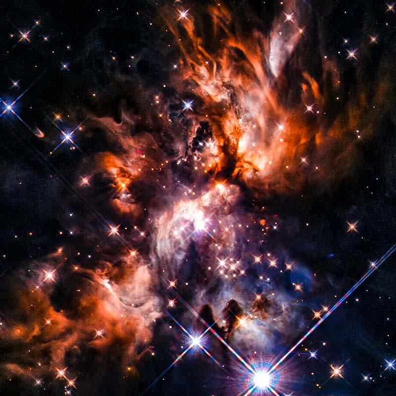 Um incrível berçário estelar escondido entre nuvens