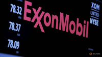 The logo of Exxon Mobil Corporation is shown on a monitor above the floor of the New York Stock Exchange in New York, December 30, 2015. (Credit: Reuters/Lucas Jackson/File Photo) Click to Enlarge.