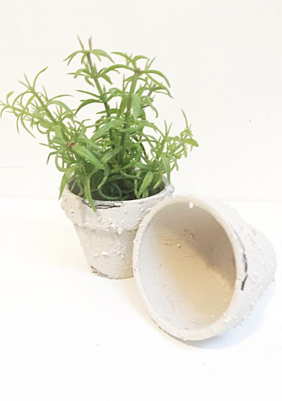 terra cotta pots with faux plant