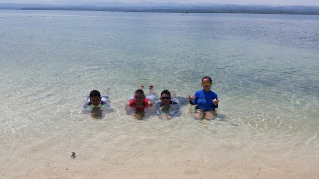Enjoying the waters at Campalabo sandbar