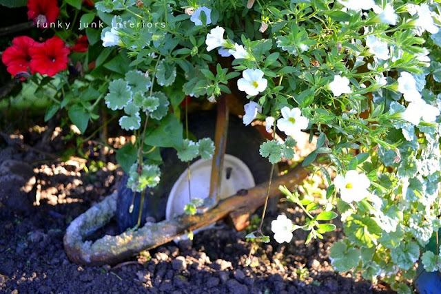 Wheelbarrow flower planter / part of summer garden reveal on FunkyJunkInteriors.net