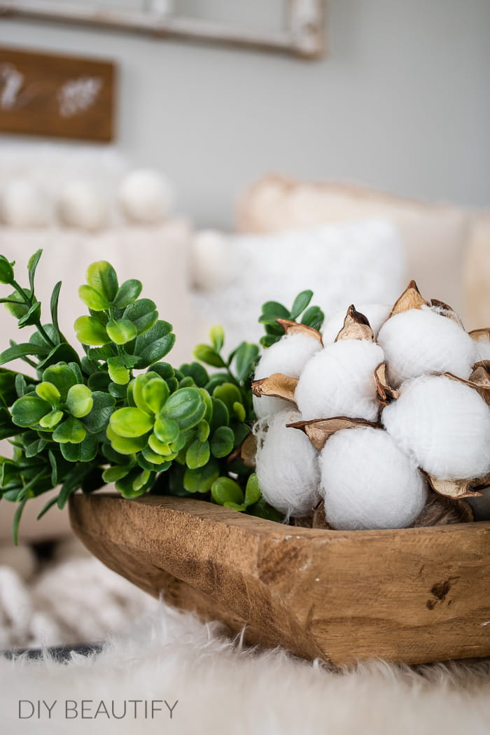 wood dough bowl with cotton and greenery