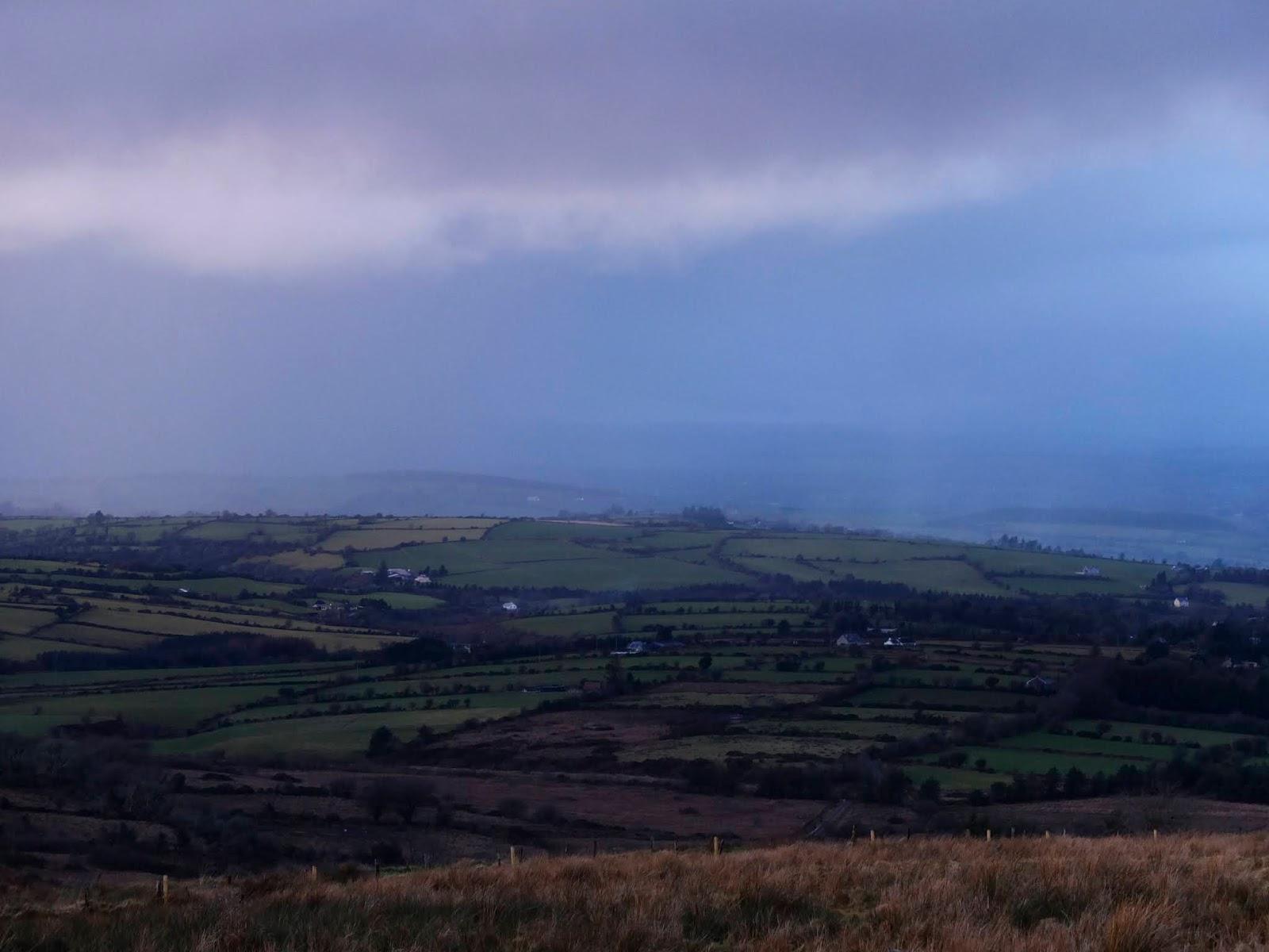 Rain clouds in a valley in North Cork bringing rain.