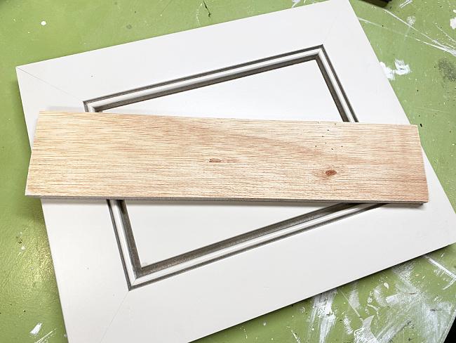 cabinet door and wood scrap