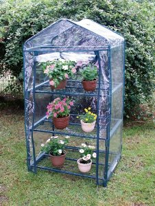 The greenhouse helps get out garden plants started.