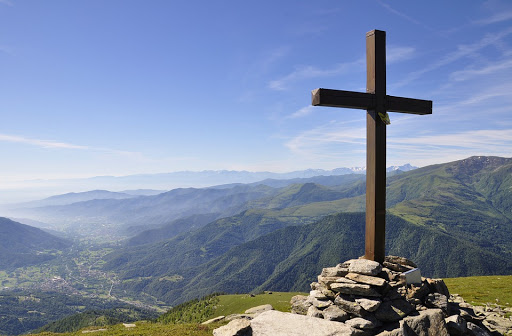 A Cross atop a mountain in the Swiss Alps