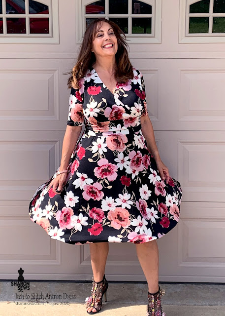 Itch to Stitch Antrim Dress in Floral ITY Knit from Fabric Mart Fabrics worn by Sharon Sews with Skirt blowing in wind