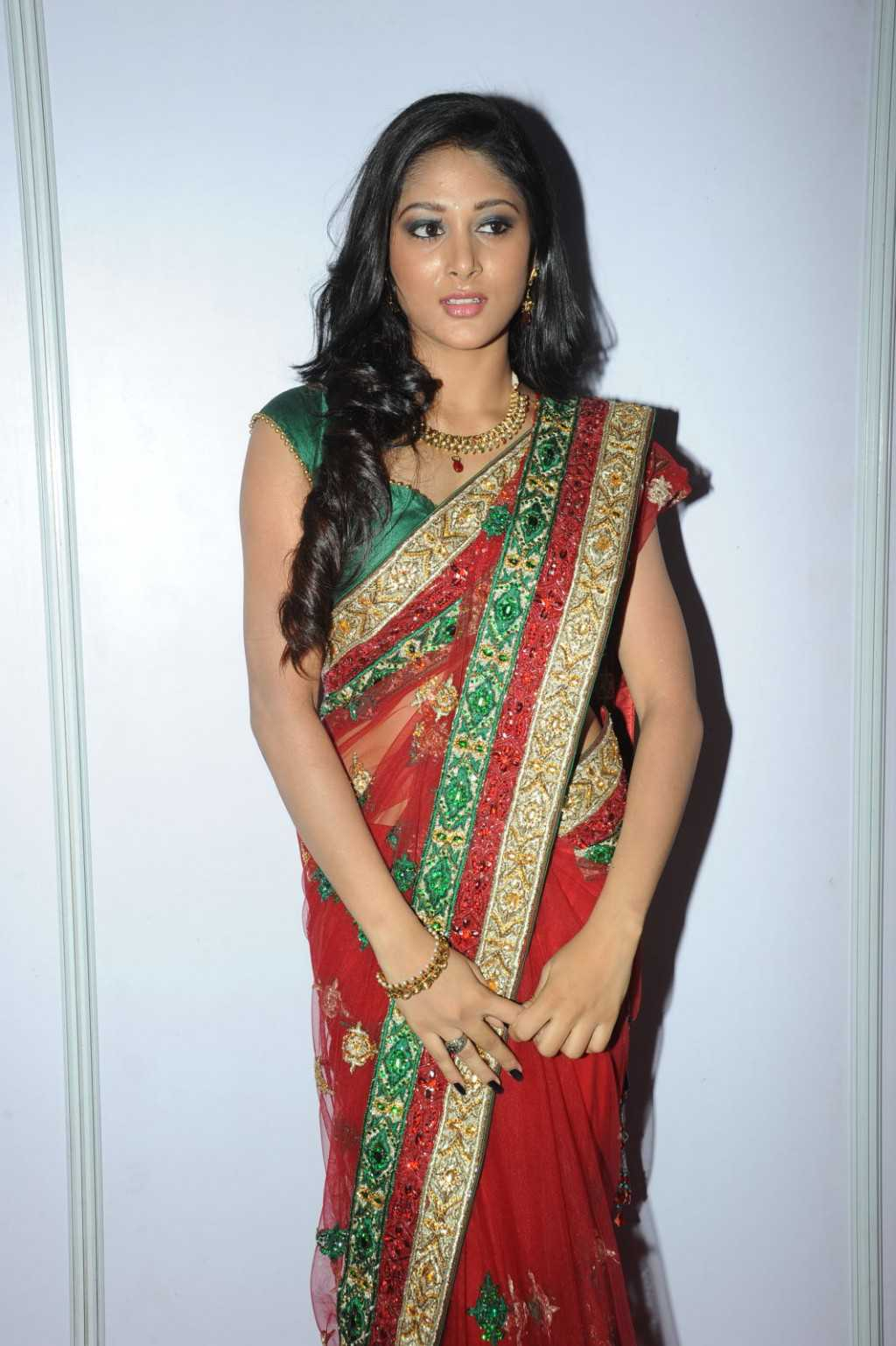 Tollywood Actress Sushma Raj Navel Hip Photos In Red Saree At Audio Launch Function