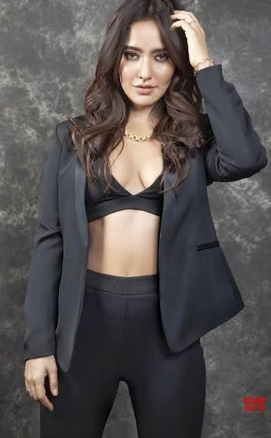 Neha Sharma Latest Hot Stills in Black Dress Showing Deep Cleavage Actress Trend