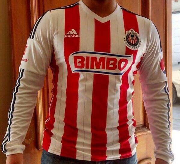 87a7b38cb3e Like last season, the new Chivas 2014-15 Home Kit features five vertical  red stripes, while small red pinstripes were added between the red stripes.
