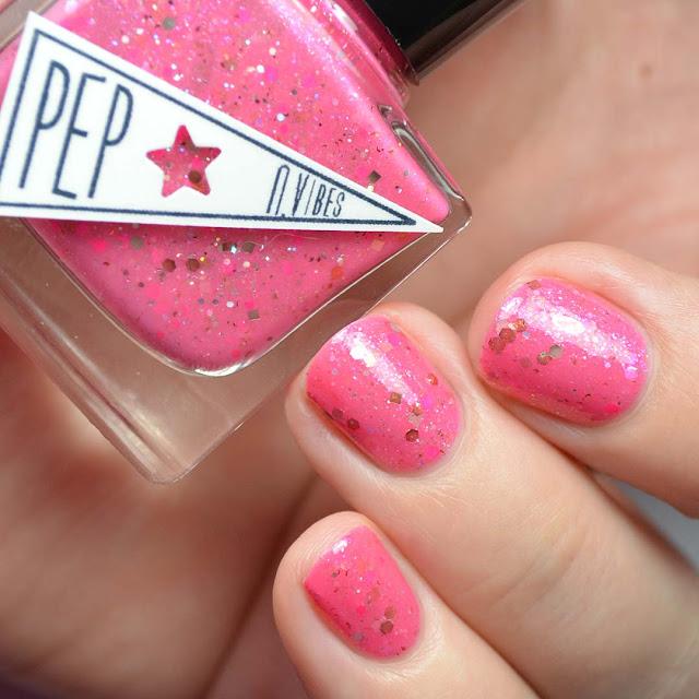 pink nail polish with glitter