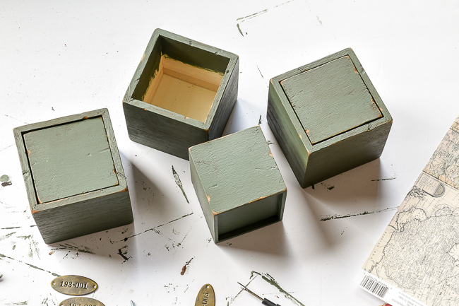 Paint and wax covered mini wood storage drawers