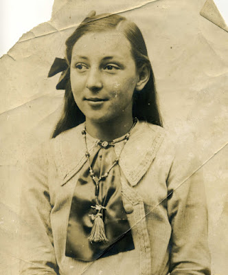 A young girl dressed in her best cloths