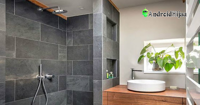 nuansa kamar mandi dengan ubin batu alam abu-abu
