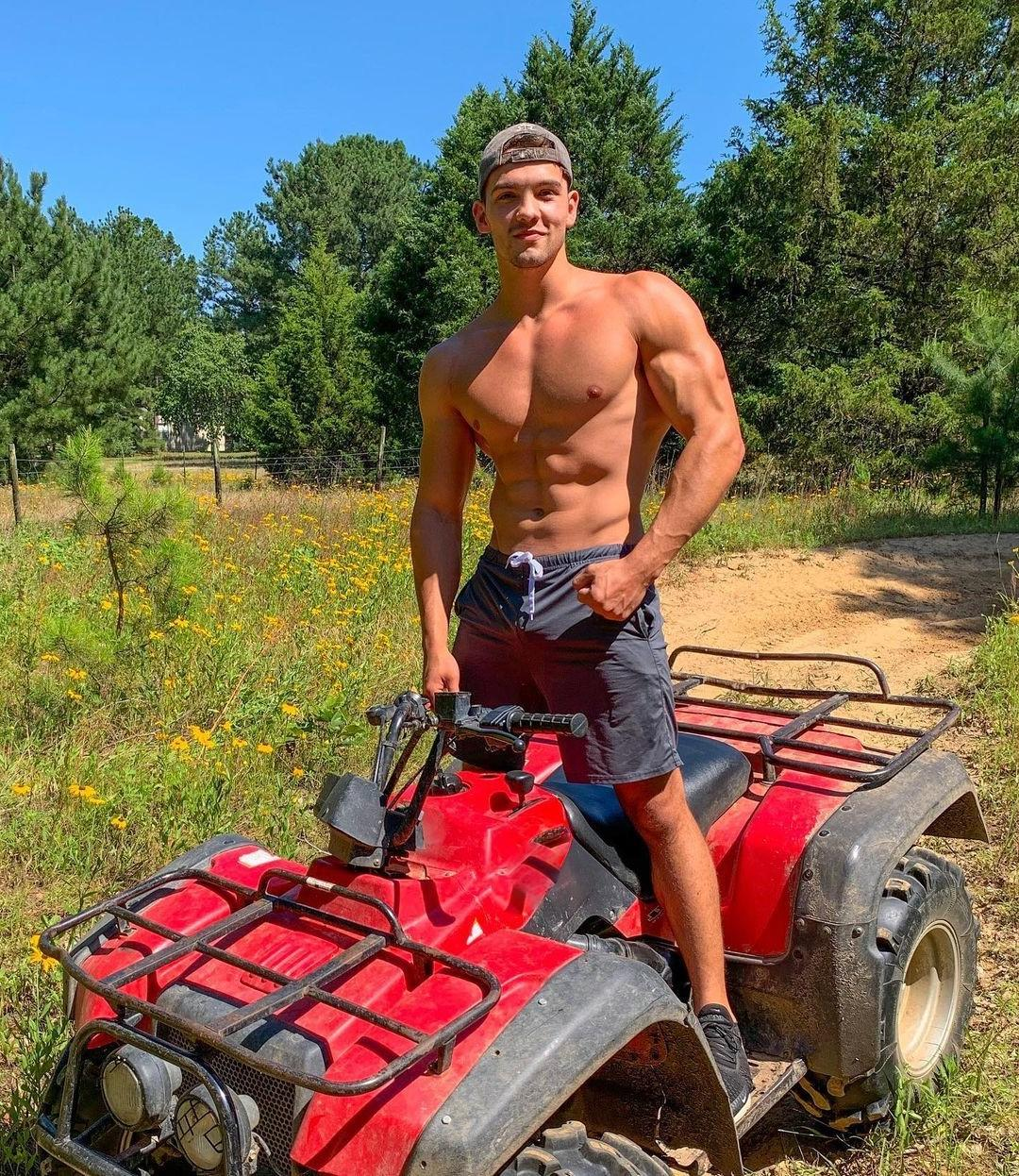 cute-fit-shirtless-baseball-cap-dude-riding-motorcycle-outdoors-adventure
