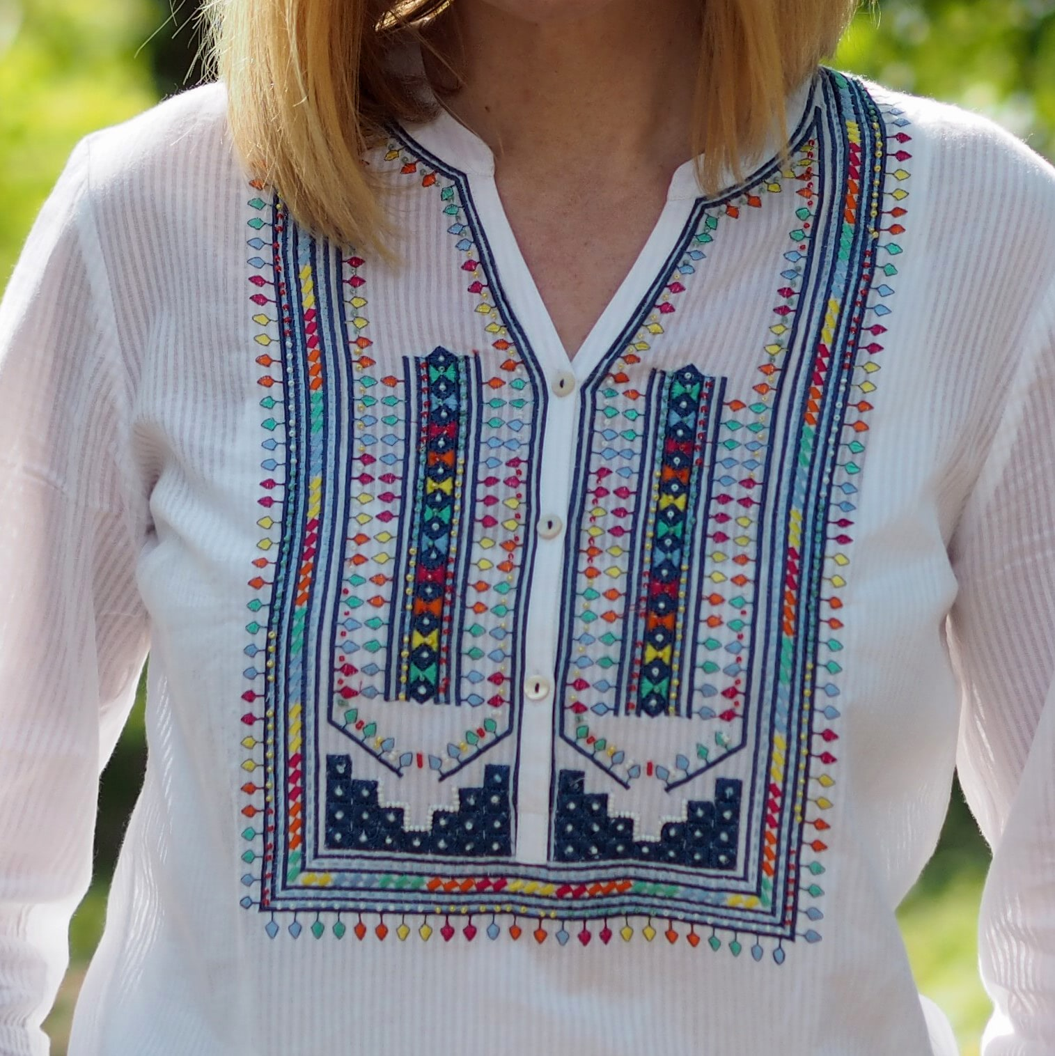 East embroidered white top