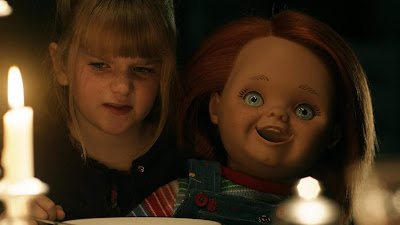"Chucky comes to life in front of Jill (Maitland McConnell) in ""Curse of Chucky"" (2013)"