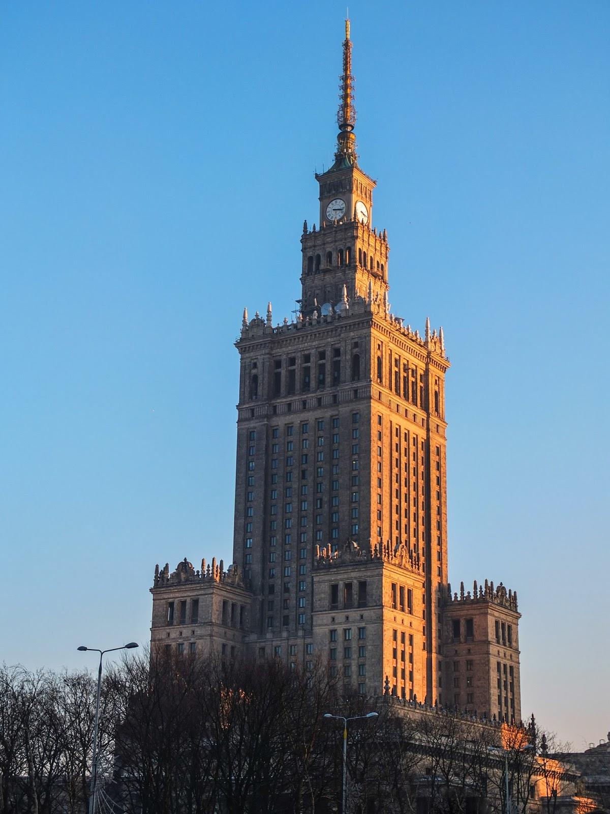 Pałac Kultury i Nauki in Warsaw at sunset.