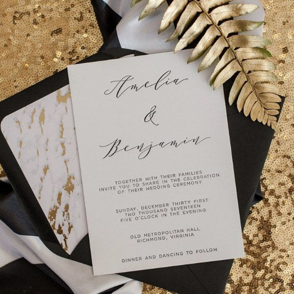 letterpress wedding invitation and black envelope with marbled liner