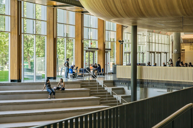 a modern university atrium with students milling around