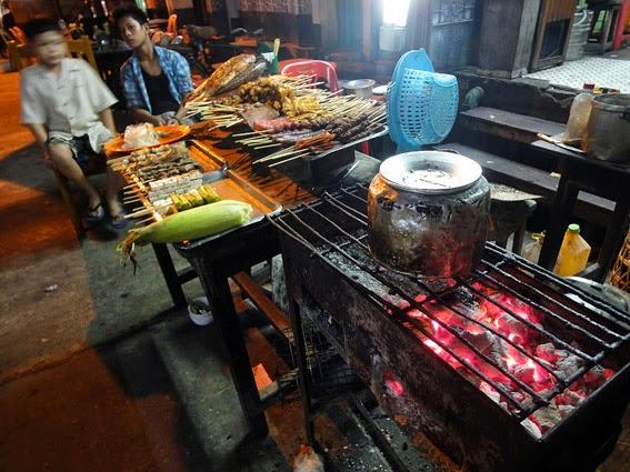 Preparing street food in the night