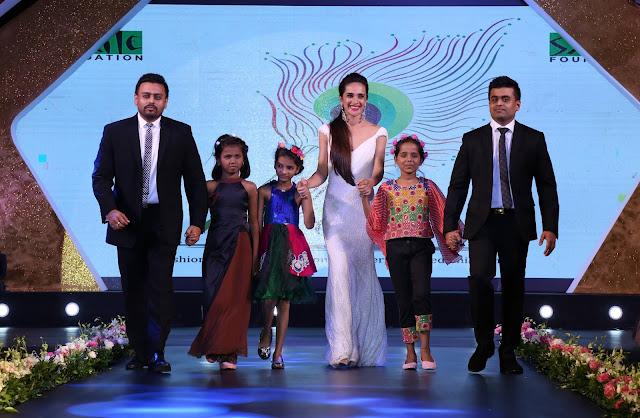 Mr. Ketan and Jatin Chokshi of Narayan Jewellers walking the ramp along with beautiful actress Tara Sharma and Smile Foundation kids at Ramp for champ event