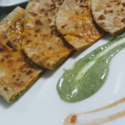 Serving paneer paratha with green chutney and tomato sauce for paneer paratha recipe