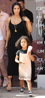 Kim Kardashian puts her curvaceous body on display as she takes daughter North out (photos)