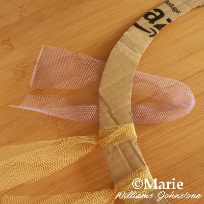 Tying netting around a circular base of thick card