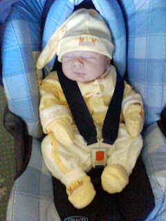 Newborn in car seat, wearing coordinating yellow outfit