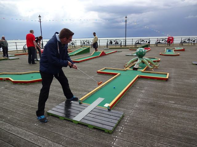 Playing Crazy Golf on Southend Pier in Essex