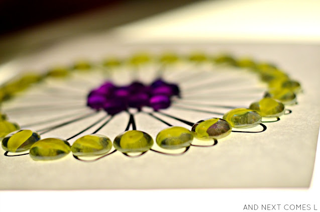 Simple light table activity for kids using glass gems and a free flower mandala printable