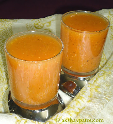 tomato soup pour in serving glasses for tomato soup recipe