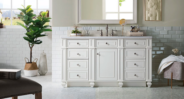 Medium white furniture look vanity by James Martin in a white tiled bathroom.