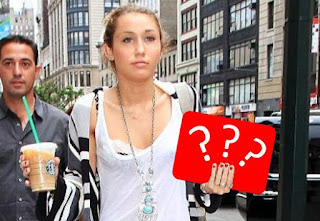 Psst! Miley Cyrus is holding this THING while walking in front of people