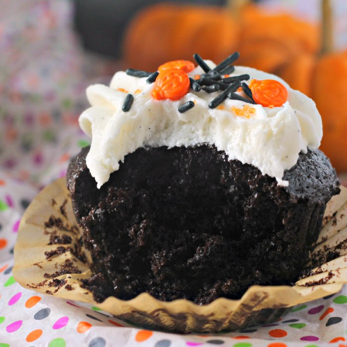 Black Magic Cupcakes with Vanilla Bean Buttercream Icing:  The BEST deep chocolate cake ever! topped with sweet vanilla bean buttercream