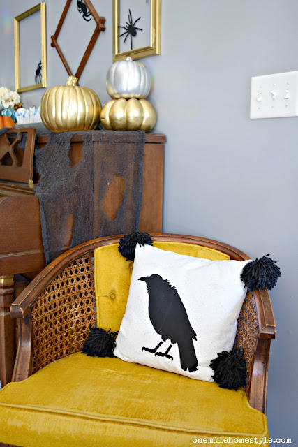 Add a little Halloween glam by spray painting plain faux pumpkins with gold and silver metallic spray paint!