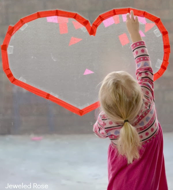 Keeps kids busy while strengthening fine-motor skills with this heart collage craft for kids! #heartcrafts #valentinesday #craftsforkids #suncatchersforkids #growingajeweledrose #craftsforvalentinesday