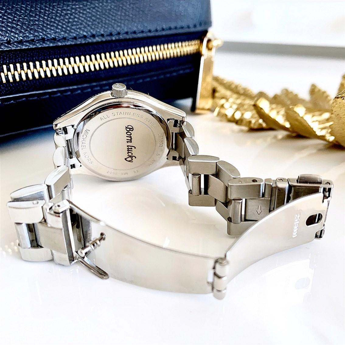 Grawer na zegarku MK