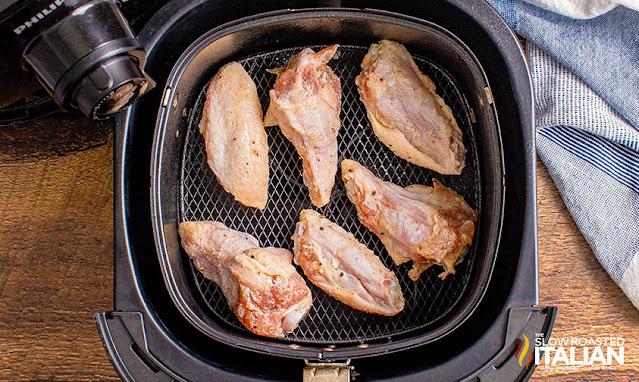 air fryer chicken wings in the basket