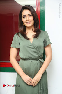 Actress Raashi Khanna Stills in Green Short Dress at Mirchi 95 Suno Aur Mercedes Jeeto Contest  0072.JPG