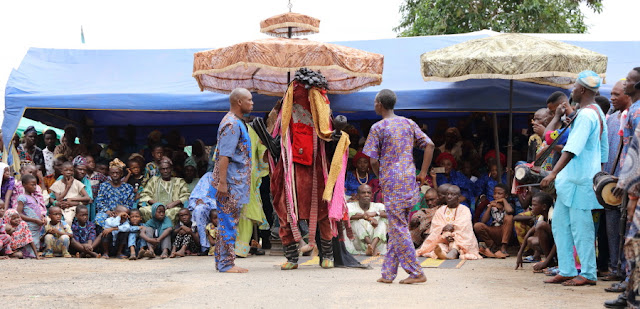 an Egungun paying his homage dance to the Oba of Osogbo