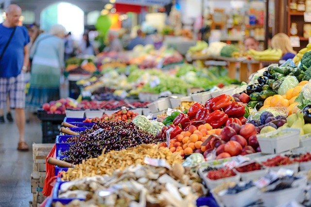 Open market stalls offering fresh produce.