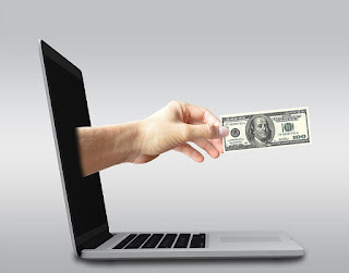 5 ways to monetize a blog -money and laptop